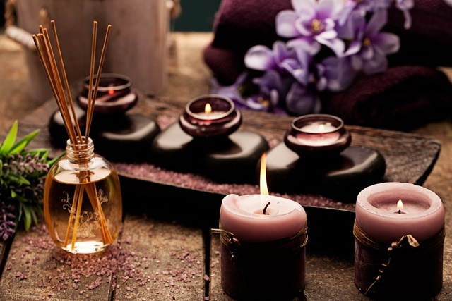 Candles, aromatherapy oil and hot stones used for spa treatments.